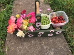 floral trug with fruit and roses